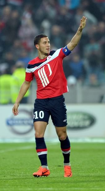 Lille's french midfielder Eden Hazard celebrates after scoring a goal during the French L1 football match Lille vs Nancy, on May 20 2012 at Lille metropole stadium in Villeneuve d'Ascq, northern France. AFP PHOTO / DENIS CHARLET        (Photo credit should read DENIS CHARLET/AFP/GettyImages)